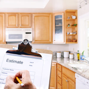 Appliance repairman writing out an estimate